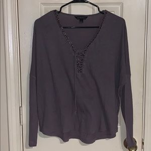 Long sleeve lace up shirt.